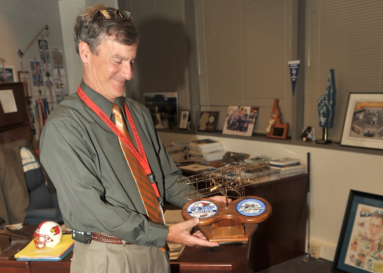 Mr. Lou Johnson, director of the Space and Missile System Center's Space Logistics Group, proudly holds his Wright B Flyer model he received for winning his his age group in 2006. Mr. Johnson is a running enthusiast and was recently recognized for his enduring support and participation in the Air Force Marathons.