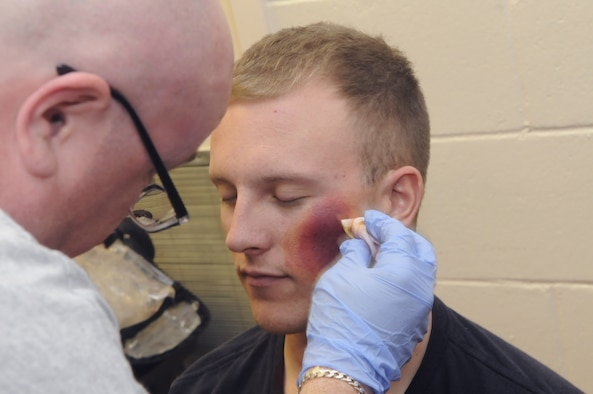 SSgt. Robert Mayner has make-up applied to simulate injuries for an exercise for the Medical Center of Central Georgia. U. S. Air Force photo by Sue Sapp