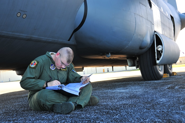 ANDERSEN AIR FORCE BASE, Guam -- SSgt Josh Plant, 36th Airlift Squadron flight engineer, completes a takeoff and landing data card before a C-130 Hercules departs here on the first day of Operation Christmas Drop Dec. 16. Operation Christmas Drop, the longest running humanitarian airlift mission in the world, delivers supplies to remote islands of the Commonwealth of the Northern Marianas Islands of Yap, Palau, Chuuk and Pohnpei. (U.S. Air Force photo/Tech. Sgt. Kimberly Spinner)