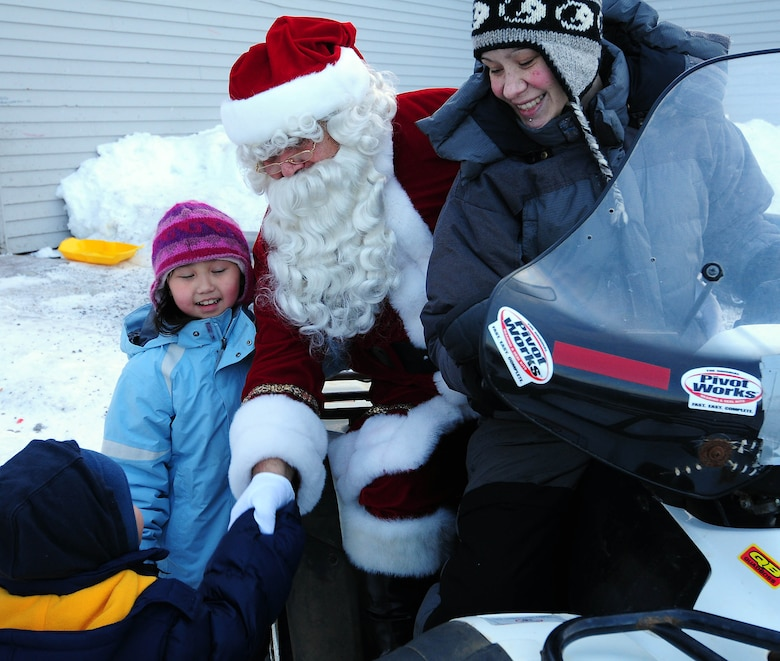 Santa bids goodbye to Gambell children after a visit to the Gambell Public School on Dec. 16, 2009. The Alaska Air and Army National Guard visited Gambell, on remote St. Lawrence Island in the Bering Sea, with Santa and a group of civilian volunteers as part of Operation Santa Claus. Now in its 53rd year, Operation Santa Claus is a program of the Alaska National Guard to bring toys, food, supplies and Christmas cheer to isolated villages around the state. Alaska Air National Guard photo by 1st. Lt. John Callahan.
