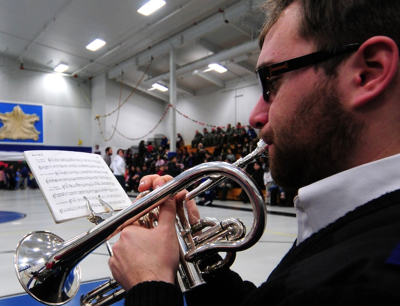 Trumpeter David Tollerud, a member of the Salvation Army Band, plays for assembled Gambell residents in the gymnasium of Gambell Public School on Dec. 16, 2009. The Salvation Army is a major supporter of Operation Santa Claus. Now in its 53rd year, Operation Santa Claus is a program of the Alaska National Guard to bring toys, food, supplies and Christmas cheer to isolated villages around the state. Alaska Air National Guard photo by 1st. Lt. John Callahan.