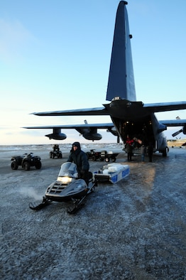 Gambell resident Merle Kaningok, an employee of the Gambell Public School, hauls a load of toys and Christmas goodies away from an Alaska Air National Guard HC-130 transport aircraft. The Alaska Air and Army National Guard were in Gambell, on remote St. Lawrence Island in the Bering Sea, with a group of civilian volunteers as part of Operation Santa Claus 2009. Now in its 53rd year, Operation Santa Claus is a program of the Alaska National Guard to bring toys, food, supplies and Christmas cheer to isolated villages around the state. Alaska Air National Guard photo by 1st. Lt. John Callahan.