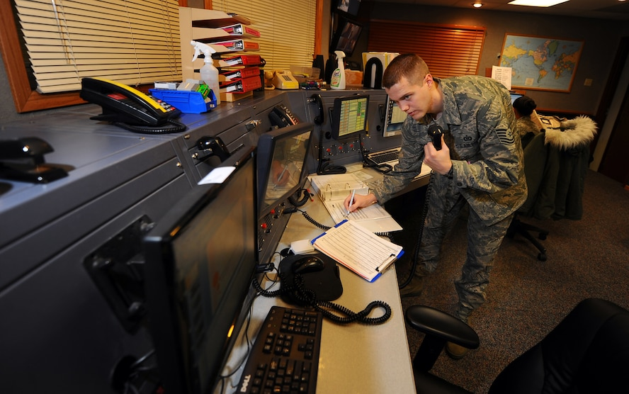 OFFUTT AIR FORCE BASE, Neb. - Tech. Sgt. Joseph H. Brandt, a 55th Wing Command Post senior emergency actions controller, transfers information from a flying schedule to a quick reaction checklist Dec. 18 at the command post here. As a command post controller, Sergeant Brandt is responsible for initiating an alert recall, notifying base agencies of emergencies and advising Offutt's senior leaders. U.S. Air Force Photo by Josh Plueger