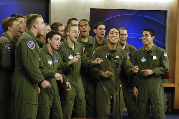 Air Force Academy Cadets with the a cappella group In the Stairwell perform for KKTV Channel 11 in Colorado Springs, Colo., Dec. 11, 2009. The group of about 20 cadets has also recently performed in a statewide competition against groups from the University of Colorado, Denver University and Colorado State University. (U.S. Air Force photo/John Van Winkle)