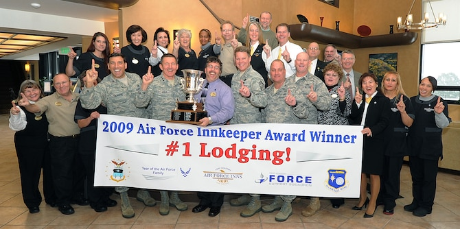 Academy leaders and Rampart Lodge staff pose for a photo in the Rampart Lodge lobby Dec. 3, 2009, after having been named the best lodging facility in the Air Force 2009 Innkeeper Awards. (U.S. Air Force photo/Rachel Boettcher)