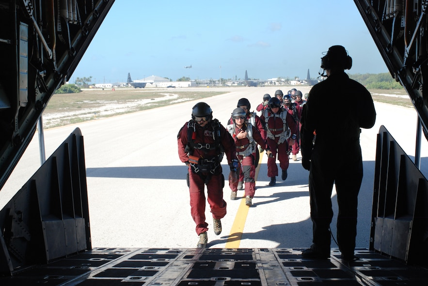 Key West, Fla. - Air Force Reserve Pararescuemen, or PJs, from the 920th RQW, along with their Canadian counterparts, SARTechs, load up in an HC-130/N for their high altitude-low opening jumps during the 2009 Key West SAREX. These jump missions, at altitudes up to 35,000 feet, are part of the Combat Search and Rescue (CSAR) missions the PJs perform. They free fall for about 2,500 feet before they deploy their parachute. (U.S. Air Force Photo/Staff. Sgt. Leslie Kraushaar)