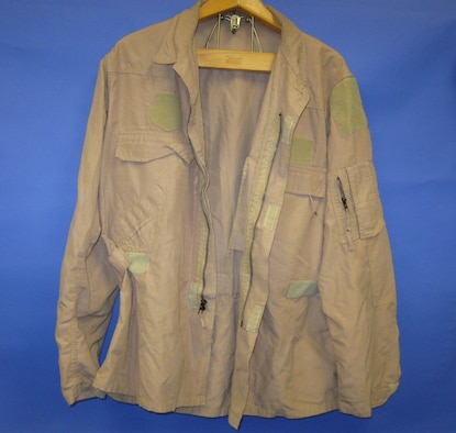 The U.S. Army distributed these two-piece flight suits to Special Operations Forces in Iraq and Afghanistan. Many aircrews preferred them because they did not bind while moving about the cabin. (U.S. Air Force photo)