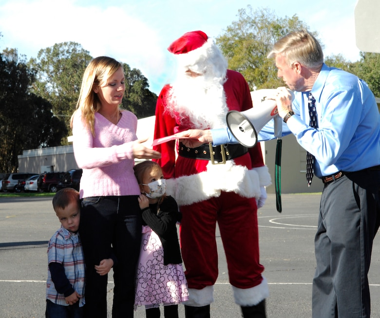 VANDENBERG AIR FORCE BASE, Calif. -- During an assembly in front of the entire student body, kindergartener Makaila Lubas, daughter of Senior Master Sgt. Frank Lubas from the 14th Air Force, is presented with a check for more than $1,600 here Friday, Dec. 18, 2009. The money was raised by the students in just three weeks after they learned of Makaila's diagnosis of leukemia. (U.S. Air Force photo/Airman 1st Class Heather R. Shaw)