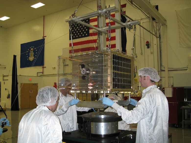 Cadets and contractors prepare FalconSAT-5 for a battery of environmental tests at the Air Force Research Laboratory at Kirtland Air Force Base, N.M., Nov. 12, 2009, prior to declaring the satellite spaceflight-worthy. Cadets briefed senior officials from the AFRL and Air Force Space Command on the status of FalconSAT-5 as well as FalconSAT-3, which has been on orbit since March 2007. (U.S. Air Force photo)