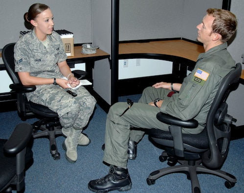 Airman 1st Class Jessica Green, 129th Rescue Wing public affairs specialist, is this month's Portrait of a Professional, shown here interviewing October 2009 Portrait of a Professoinal, Staff Sgt. Joshua Webster, 131st Rescue Squadron pararescueman. (Air National Guard photo by Master Sgt. Dan Kacir)