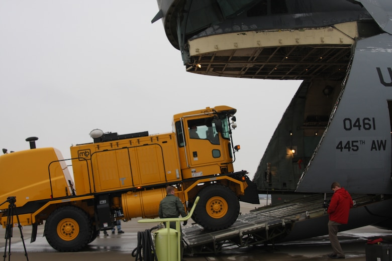 WRIGHT-PATTERSON AIR FORCE BASE, Ohio - The 445th Airlift Wing participated with the Air Force Security Assistance Center and the 88th Air Base Wing Dec. 23 to transport two snow removal vehicles and associated snow removal equipment from Wright-Patterson Air Force Base to its final destination of Kabul, Afghanistan. The plows will be used to clear runways at Kabul International Airport for the Afghan National Army Air Corps.  (U.S. Air Force photo/Stacy Vaughn)