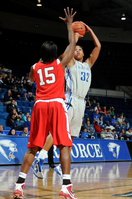 Falcons freshman forward Dymond James takes a jump shot as Braves junior forward Sonya Harris attempts to block during the Air Force-Bradley game at the Air Force Academy's Clune Arena Dec. 19, 2009. James, a native of Brambleton, Va., had a career-high 10 points and seven rebounds in the Falcons' 62-45 loss. (U.S. Air Force photo/J. Rachel Spencer)