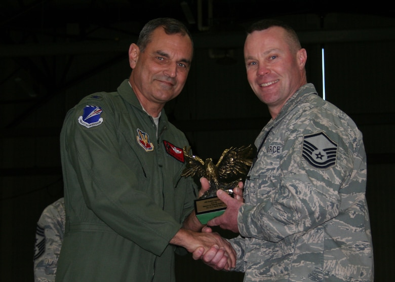Master Sgt Ken Huff, 131AMXS, receives an Eagle trophy from Col Robert Leeker, 131st Bomb Wing commander, during the 131st Outstanding Airman of the Year awards on Dec 5 at Whiteman Air Force Base.  Huff was recognized for his contributions to Lambert ANGB to Whiteman AFB transition efforts.  (Air Force Photo by Tech Sgt Chris Boehlein   RELEASED)