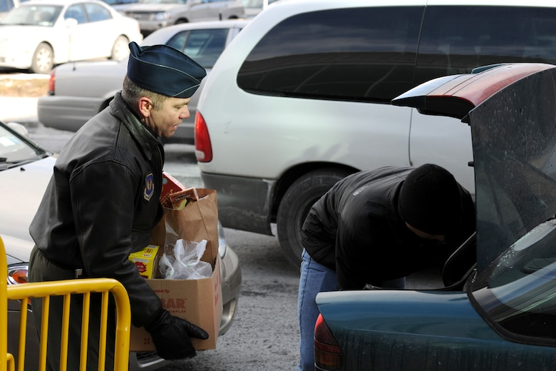 US Air Force 152nd Air Operations Group Commander Lt. Col. Richard D. Howard loads a box of food items into a trunk at the Oncenter Complex in Syracuse, NY on 22 Dec. 2009. Howard was volunteering at the Annual Christmas Bureau Salvation Army Food and Gift drive supplying needy families with gifts for their children and food for their Holiday meal. (US Air Force photo by Tech. Sgt. Jeremy M. Call/Released)