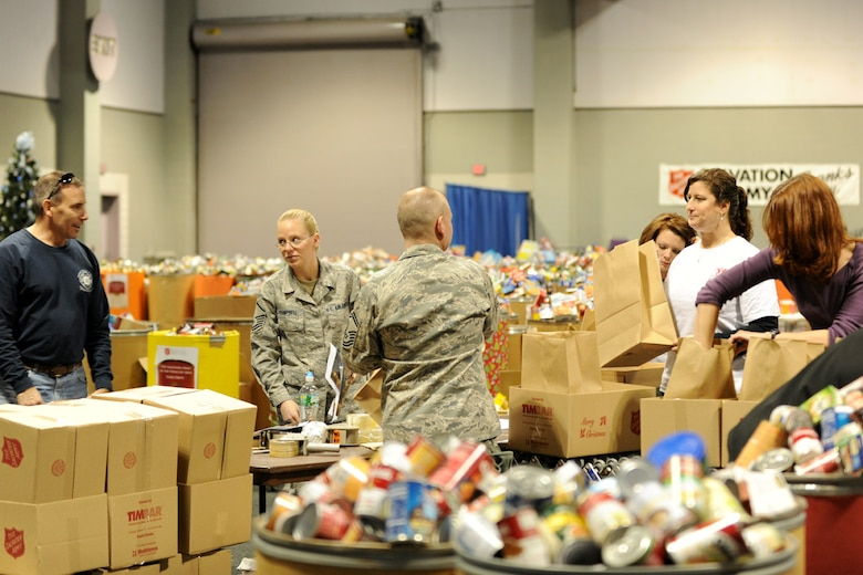 Members of the New York Air National Guard's 174th Fighter Wing, along with local volunteers fill boxes with food at the Oncenter Complex in Syracuse, NY on 22 Dec. 2009. All were assisting with the Annual Christmas Bureau Salvation ArmyFood and Gift drive supplying needy families with gifts for their children and food for their Holiday meal. (US Air Force photo by Tech. Sgt. Jeremy M. Call/Released)