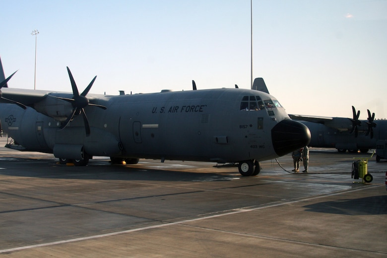 "A C-130J Hercules prepares for a mission for Operation Enduring Freedom at an undisclosed base in Southwest Asia on Dec. 25, 2009. The C-130 is one of the lead airlift aircraft the Air Force and Air Mobility Command uses to ""fly, fight and win...in air, space and cyberspace."" (U.S. Air Force Photo/Tech. Sgt. Scott T. Sturkol)"
