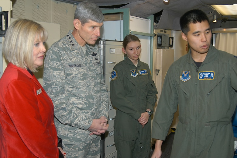 Capt. Irwin Hui (right) and 1st Lt. Sydney Todorov, missile combat crewmembers with the 320th Missile Squadron at F.E. Warren Air Force Base, Wyo., brief Air Force Chief of Staff Gen. Norton Schwartz and Mrs. Schwartz Dec. 25, 2009, inside the launch control center of a missile alert facility.  The general and Mrs. Schwartz visited the base during Christmas to thank Airmen in 24-hour work centers and to reinforce the Air Force's commitment to the nuclear enterprise.  (U.S. Air Force photo/Capt. Mary Danner)