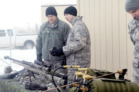 Chief Master Sgt. of the Air Force James Roy is shown weapon equipment Dec. 24, 2009, by Airman First Class Justin Allison from the 91st Missile Security Forces Squadron at Minot Air Force Base, N.D.  Chief Roy spent the Christmas holiday there and used the opportunity to meet Airmen from both the 5th Bomb Wing and the 91st Missile Wing and tell them their work in the nuclear enterprise is critical and that Air Force leaders are committed to their development.  (U.S. Air Force photo/Senior Airman Jesse Lopez)