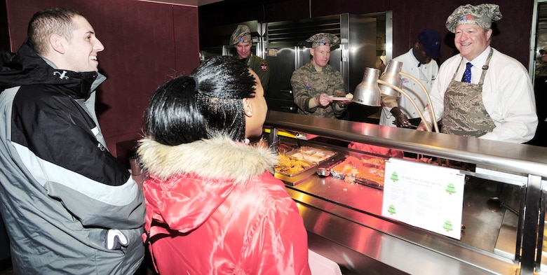 Secretary of the Air Force Michael B. Donley serves Christmas Day dinner at the Gingko Tree Dining Facility at Osan Air Base, South Korea. Secretary Donley met with Airmen assigned to the 51st Fighter Wing, 8th Fighter Wing, 7th Air Force and South Korean airmen during his two-day trip to the peninsula. (U.S. Air Force photo/1st Lt. Chris Hoyler)