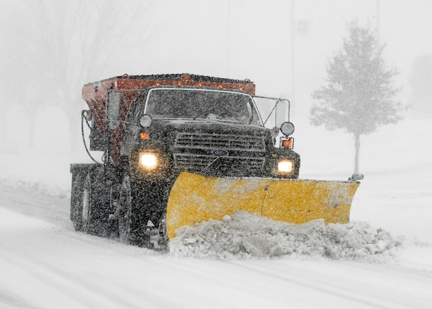 A truck with a snow blade clears a road on Sheppard Air Force Base, Texas, Dec. 24 after a blizzard blew through North Texas. Some places in the region received 10-15 inches of snow and ice. (U.S. Air Force photo/Harry Tonemah)