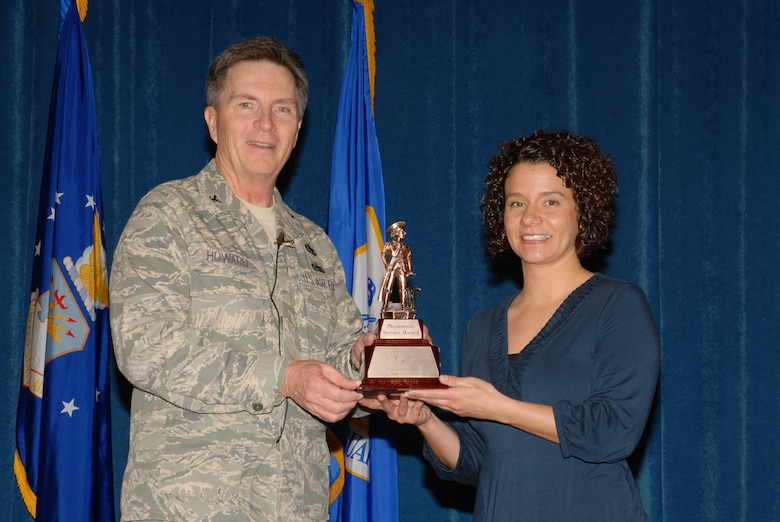McGHEE TYSON AIR NATIONAL GUARD BASE, Tenn. -- Tech. Sgt. A. Ramey Stokes, right, an enlisted professional military education instructor, receives the meritorious service award from Col. Richard B. Howard, commander, upon her departure from assignment at The I.G. Brown Air National Guard Training and Education Center here, Dec. 18, 2009.  (U.S. Air Force photograph by Master Sgt. Mavi Smith/Released)