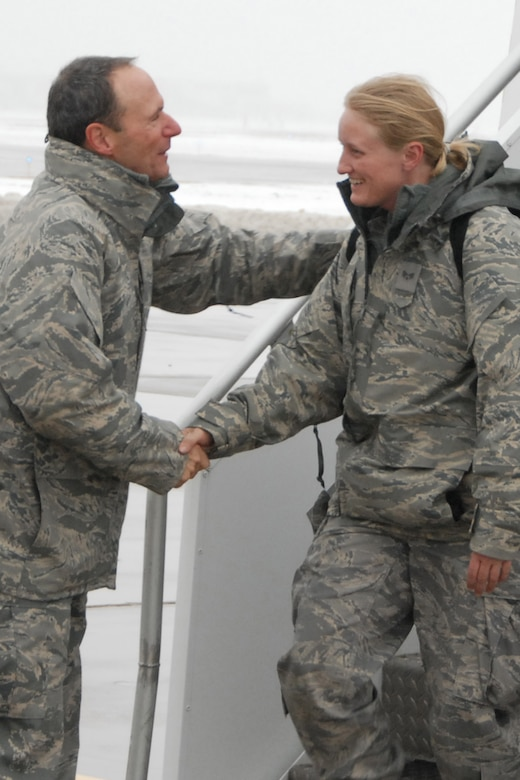 Brig. Gen. Gregory Schwab, Deputy Adjutant General  Air, Iowa National Guard, welcomes home Senior Airman Kelly Farris. Senior Airman Harris along with 250 other unit members returned to the 132nd Fighter Wing, Des Moines, Iowa Christmas Eve, 12/24/2009, after completing an AEF rotation to Joint Base Balad, Iraq. (U.S. Air Force/Senior Master Sgt. Tim Day)(released)