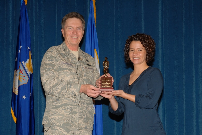 McGHEE TYSON AIR NATIONAL GUARD BASE, Tenn. -- Tech. Sgt. A. Ramey Stokes, right, an enlisted professional military education instructor, receives the National Guard Bureau minuteman award from Col. Richard B. Howard, commander, upon her departure from assignment at The I.G. Brown Air National Guard Training and Education Center here, Dec. 18, 2009.  (U.S. Air Force photograph by Master Sgt. Mavi Smith/Released)