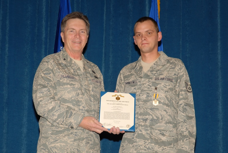 McGHEE TYSON AIR NATIONAL GUARD BASE, Tenn. -- Col. Richard B. Howard, left, commander, presents the Air Force Commendation medal to Staff Sgt. Adam B. Thornton, an enlisted professional military education instructor, upon his departure from assignment at The I.G. Brown Air National Guard Training and Education Center here, Dec. 18, 2009. (U.S. Air Force photograph by Master Sgt. Mavi Smith/Released)