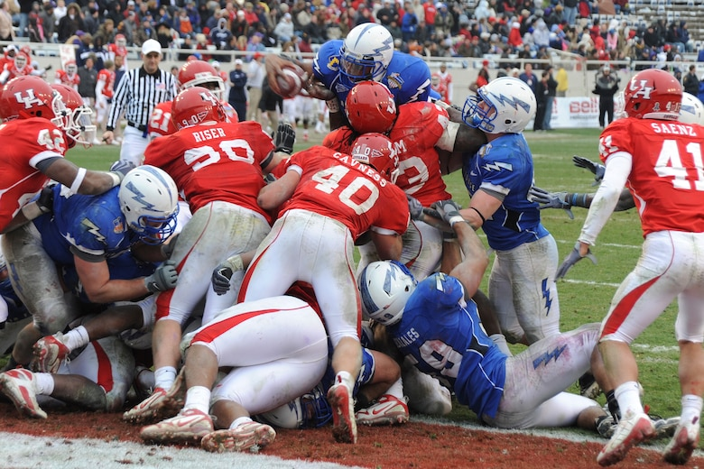 Falcons sophomore quarterback Tim Jefferson goes airborne for a touchdown on fourth and goal from the 1 during the Bell Helicopter Armed Forces Bowl in Fort Worth, Texas, Dec. 31, 2009. Jefferson, an Atlanta native, had 161 passing yards and 37 rushing yards in Air Force's 47-20 victory. (U.S. Air Force photo/Bill Evans)
