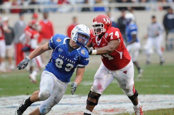 Falcons senior defensive lineman Ben Garland tries to beat a block by Cougars offensive lineman Roy Watts during the Armed Forces Bowl in Fort Worth, Texas, Dec. 31, 2009. Air Force's defense held Houston to 331 total yards and intercepted Houston quarterback Case Keenum six times in the Falcons' 47-20 victory. Garland is a native of Grand Junction, Colo. (U.S. Air Force photo/Bill Evans)