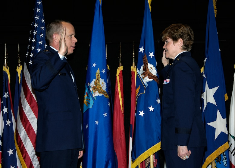 Gen. Donald J. Hoffman, commander of Air Force Materiel Command, re-administers the oath of office to Lt. Gen. Janet C. Wolfenbarger during a Dec. 30 promotion ceremony at the National Museum of the United States Air Force.  General Wolfenbarger's new three-star rank and position as the Vice Commander of AFMC were confirmed by the U.S. Senate Dec. 4.  (U.S. Air Force Photo/Mike Libecap)