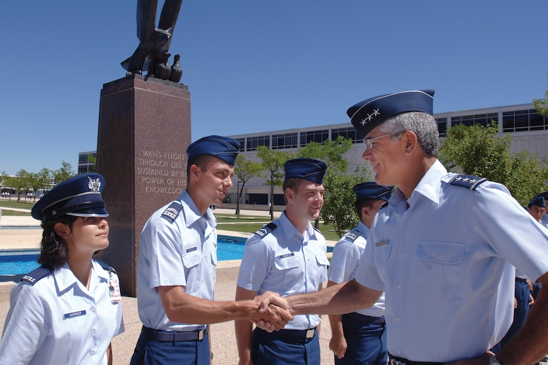 Lt. Gen. John Regni, the Air Force Academy's superintendent, greets cadets.  General Regni will retire from active duty later this year.  He is the Academy's 17th superintendent.  (U.S. Air Force photo)