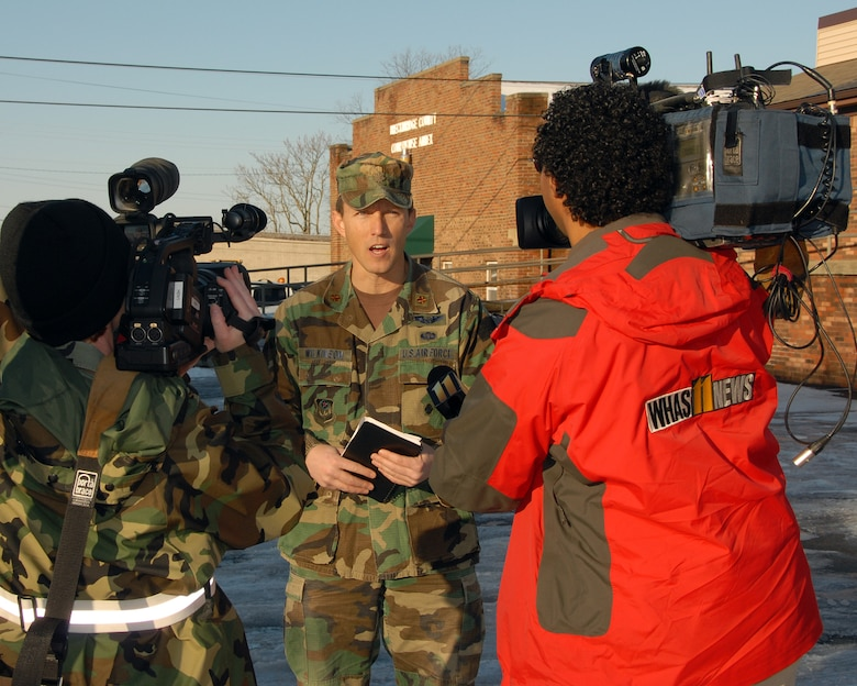 Major Jeff Wilkinson of the Kentucky Air National Guard gives an interview to ABC affiliate WHAS-11 of Louisville, KY and Public Affairs members of the KY Air Guard during ice storm relief efforts in Hardinsburg, KY. (Photo by Tech. Sgt. Dennis Flora / KyANG)