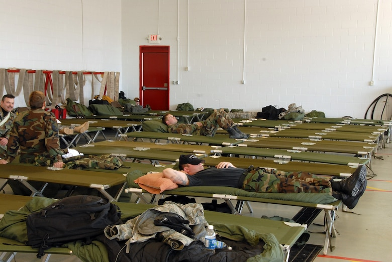 """Members of the Kentucky Air National Guard relax at the Hardinsburg, KY. fire department after a long day of """"Wellness Checks"""" in Hardinsburg area.  (Photo by Tech. Sgt. Dennis Flora / KyANG)"""