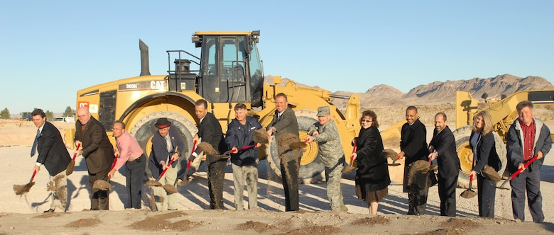 NELLIS AIR FORCE BASE, Nev. – Air Force and North Las Vegas leadership break ground for the new $257 million water reclamation facility. The construction of the facility will create approximately 500 jobs and be capable of treating 25 million gallons of waste-water per day. (U.S. Air Force photo bay Staff Sgt. Erin Worley)