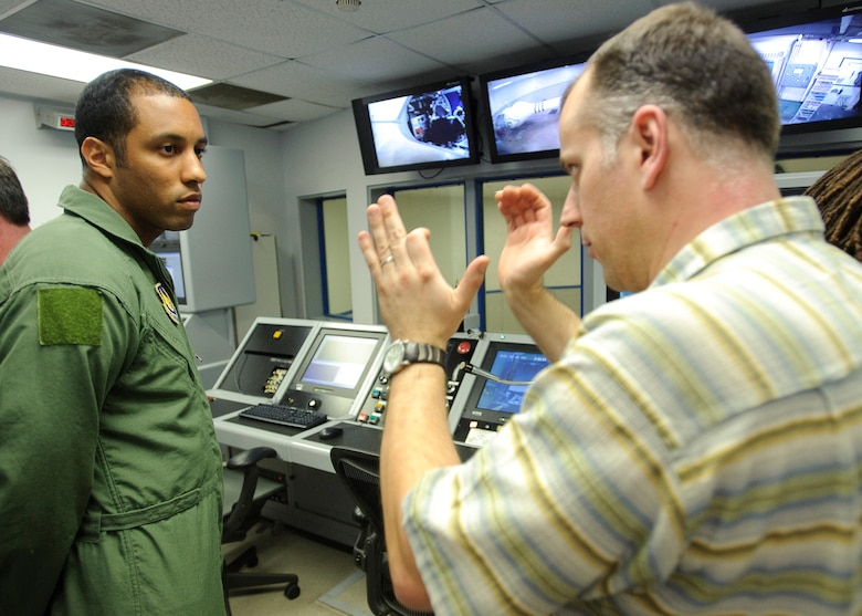 BBC Producer Paul King, right, directs  Staff Sgt. Andre Scott, Aerospace Physiology Technician with the Air Force Research Laboratory, during production of a documentary by BBC, which commemorates the 40th anniversary of the Apollo 11 mission, the first to put a man on the Moon.  James May was spun to several Gs in the AFRL Centrifuge at Brooks City-Base, TX.  His experience allowed  him to be more familiar with the experiences of Apollo 11 Astronauts Neil Armstrong, Michael Collins, and Edwin E. Aldrin, Jr., during the initial phase of launch which entered orbit of the Earth 12 minutes after takeoff.  (US Air Force photo/Steve Thurow)