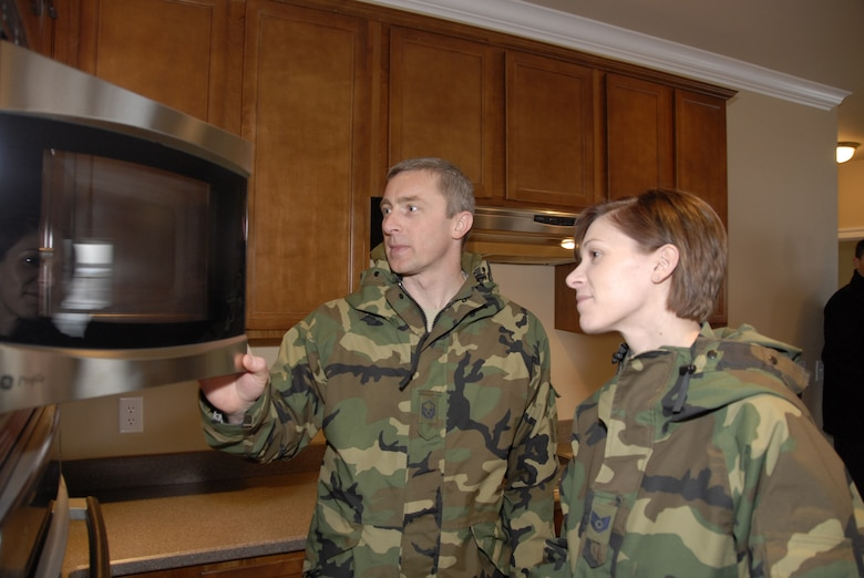 Master Sgt. Kevin Sandberg and Tech. Sgt. Jamie Eastlick,115th Fighter Wing, tour the new kitchen in injured Army veteran Staff Sgt. Charles Isaacson's new home. The home was built through the non-profit Homes for Our Troops program for Sergeant Isaacson and his wife, Brenda.  More than 10 Airmen from the 115 FW contributed to the home, located in Sun Prairie, during a three-day build brigade. The home features many of the special accomodations that Sergeant Isaacson needs to accomodate his injuries from the War on Terror. (U.S. Air Force Photo by Master Sgt. Dan Richardson)