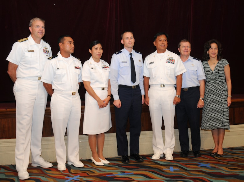 ANDERSEN AIR FORCE BASE, Guam -  Project officers for the Combined Federal Campaign at Andersen and Naval Base Guam pose with Guam's  First Lady Joann Camacho, Rear Admiral William French,  U.S. Naval Forces Marianas commander, and Brig. Gen. Philip Ruhlman, 36th Wing commander, at the CFC award ceremony on Feb. 2 at the Hilton Guam Resort & Spa. The 36th Wing and Naval Forces Marianas increased donations by more than 11 percent from 2007. (U.S. Air Force photo by Staff Sgt. Jamie Lessard)
