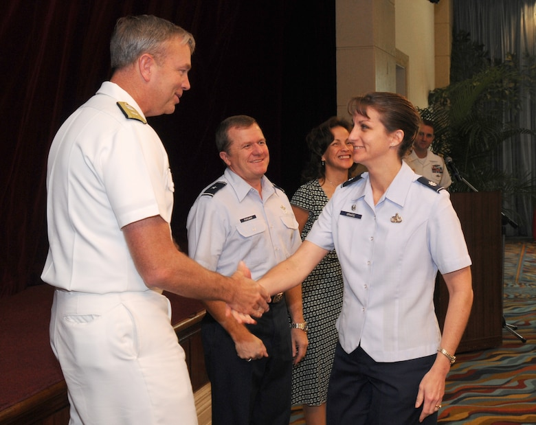 ANDERSEN AIR FORCE BASE, Guam – Rear Admiral William French, U.S. Naval Forces Marianas commander, presents the Combined Federal Campaign silver award to Lt. Col. Kathleen Grasse, 36th Communications Squadron commander, during the CFC award ceremony Feb. 2 at the Hilton Guam Resort & Spa. Team Andersen raised more than $153,000 this year. (U.S. Air Force photo by Staff Sgt. Jamie Lessard)