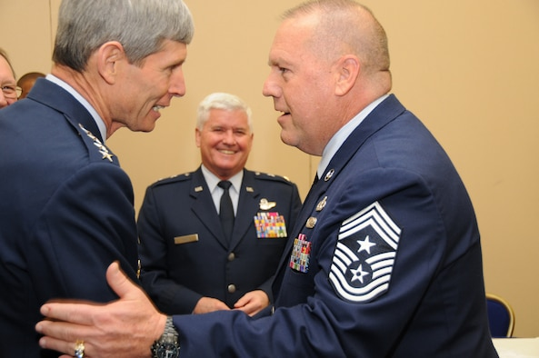 Chief Master Sgt. John Anderson, 94th Airlift Wing command chief, greets General Norton Schwartz, Chief of Staff of the U.S. Air Force, Feb. 4 during an Air Force Reserve senior leaders conference in Washington D.C. The two served together years ago.