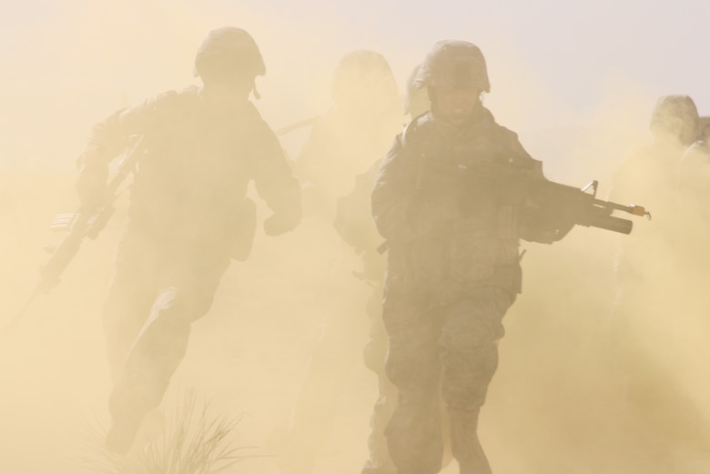 Airmen from the 376th Expeditionary Security Forces Squadron charge toward their objective during a training exercise at McGregor Range, N.M. Photo by Maj. Deanna Bague, Fort Bliss Public Affairs Office