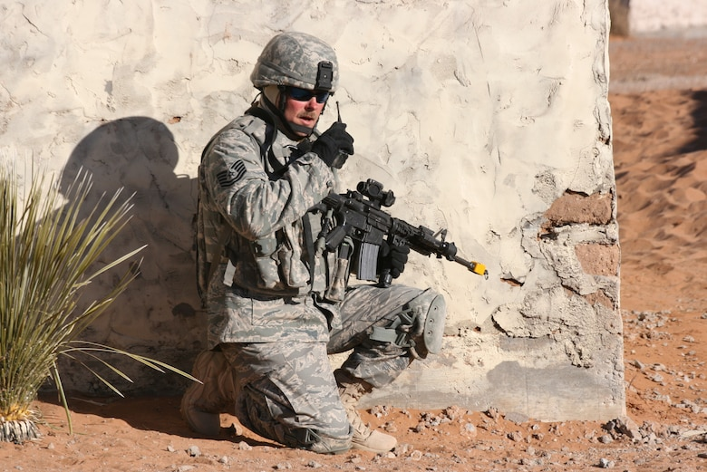An Air Force Tech Sergeant from the 376th Expeditionary Security Forces Squadron radios for fire support during a training exercise at McGregor Range, N.M. Photo by Maj. Deanna Bague, Fort Bliss Public Affairs Office