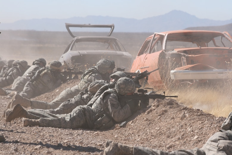 Airmen from the 376th Expeditionary Security Forces Squadron fire at multiple targets in the prone firing position during a convoy live fire exercise at McGregor Range, N.M.  Photo by Maj. Deanna Bague, Fort Bliss Public Affairs Office