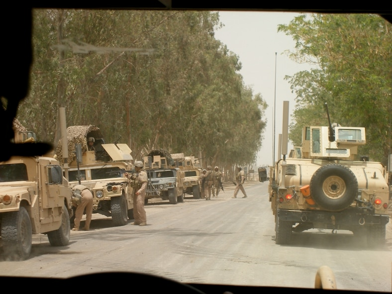A line-up of military vehicles, several of which have CREW systems attached to jam radio signals and prevent the detonation of RCIEDs. Photo courtesy of Master Sgt. Steven Sutton.
