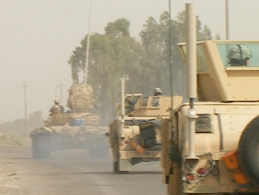 The large antennas that are part of the CREW system are easy to spot on the Army vehicles in convoy. Photo courtesy of Master Sgt. Steven Sutton.