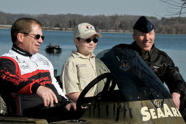 (L-R) Jake Davis, National Sales Director for All Pro Rods, Hank Lowrie and AEDC Commander Col. Art Huber sit onboard a boat being launched at Morris Ferry Dock commemorating the official re-opening of the ramp to the public Friday. Lowrie, the son of David Lowrie and grandson of Jim Lowrie, all of whom attended Friday's ceremony, is the fourth generation of fishermen who have fished on Woods Reservoir.  Jim's father, Harold, began the legacy in the 1950s. (Photo by Rick Goodfriend)