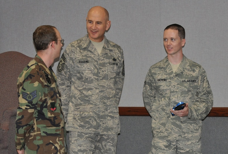 Command Chief Master Sgt. Steve Sullens, Air Combat Command, quizzes Staff Sgt. Richard Todd, left, on what he knows about Senior Airman Joseph Andrews, 68th Electronic Warfare Squadron, during an enlisted call Feb. 3 here. Airman Andrews was presented Airman of the Year award from thelocal Air Force Sergeants Association chapter before his supervisor Sergeant Todd was asked to come to the front of the room. The chief did this exercise a few times during his week-long visit to Eglin to demonstrate a supervisor should be involved in their Airmen's life. (U.S. Air Force Photo/Chrissy Cuttita)