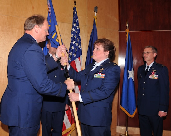 SALT LAKE CITY, Utah ? Lt. Col. Karen Morris receives the guidon from Brig. Gen. David Hooper, Assistant Adjutant General for Air, during a change of command ceremony February 8 in the 151st Air Refueling Wing Headquarters auditorium.   Colonel Morris is the new commander of the 130th Engineering and Installation Squadron.  She has served as both an enlisted member and an officer in the 130th.  U.S. Air Force photo by Tech. Sgt. Mike Evans