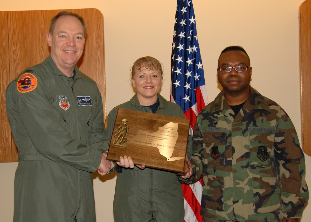 "Lt. Col. (Dr.) Lalainia M. Secreti of the 174th Fighter Wing Medical Group is awarded the New York State ""Colonel Gouverneur Morris Citizen Soldier Award"" by the 174th Fighter Wing Comander Col. Kevin Bradley and 174th Fighter Wing Medical Group Commander Col. (Dr.) Wenzell Carter"