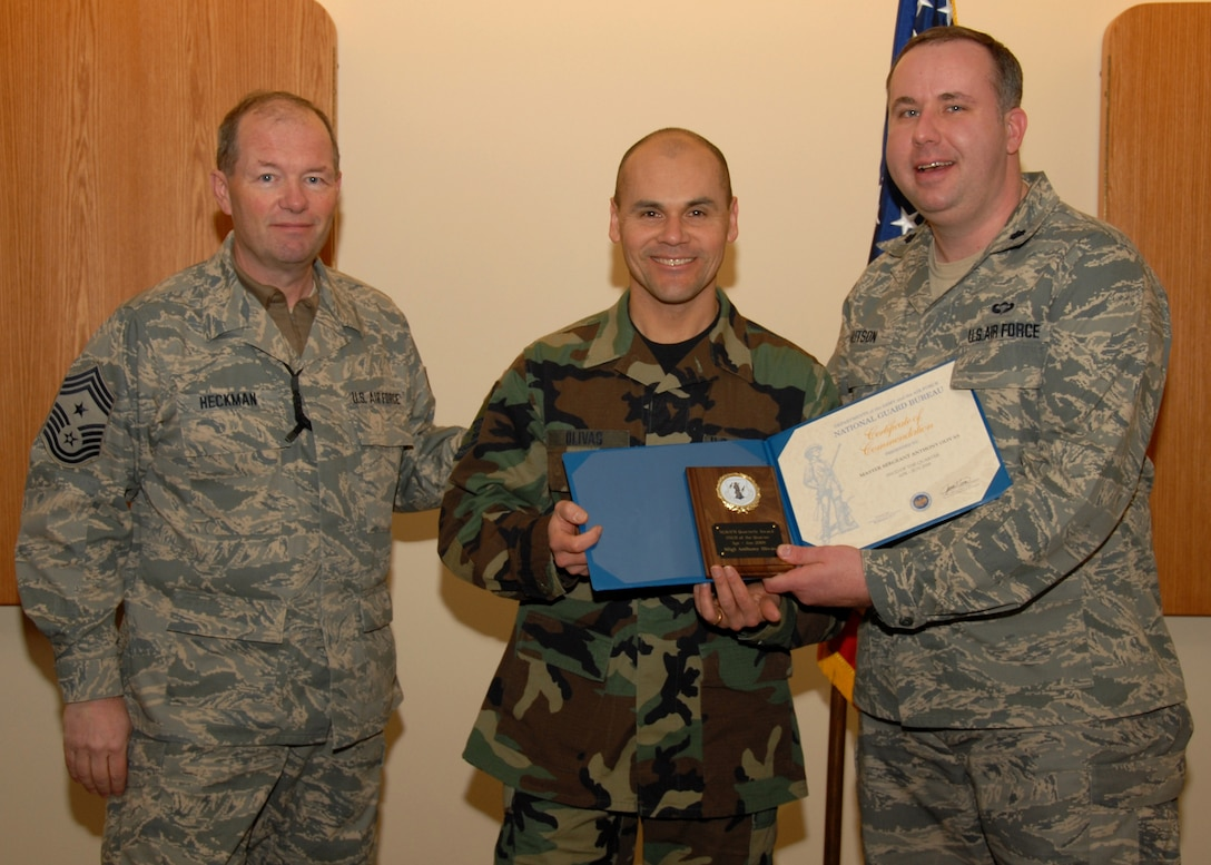 MSgt. Anthony Olivas, a Finance Specialist with the 174th Fighter Wing is presented the Air National Guard Seinor Non-Commisioned Officer of the Year Award for 2008. Presenting the award is the 174th Wing Command CMSgt. David Heckman and the 174th Firghter Wing Comptroller Lt. Col. Charles Hutson.